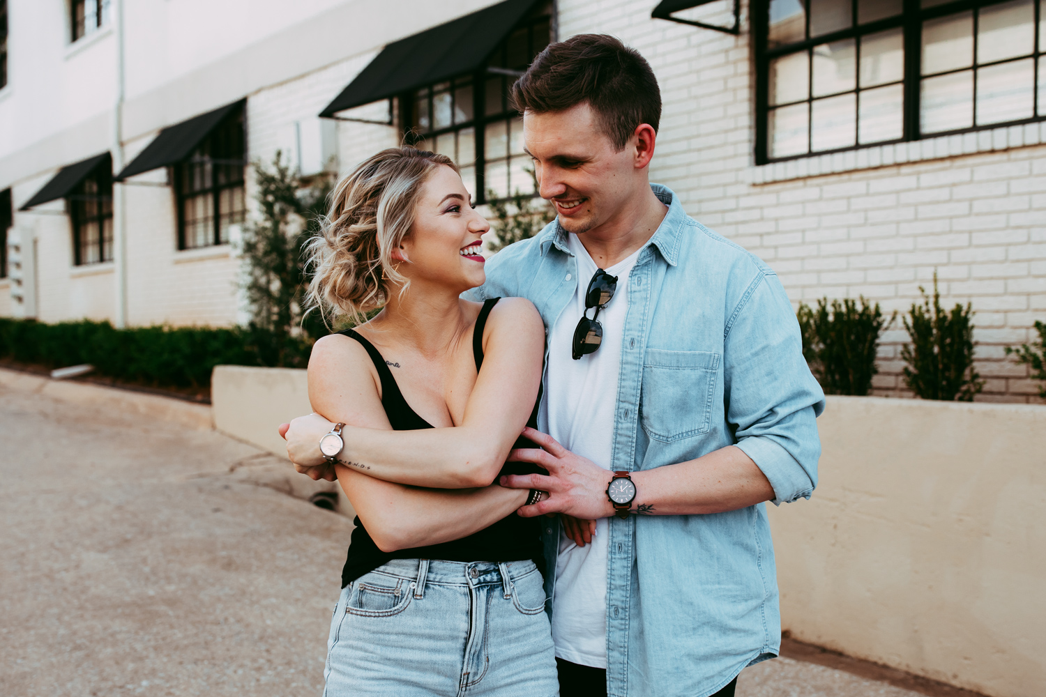 Cute urban couple dancing and embracing in an alleyway in the Paseo District of Oklahoma City by Amanda Lynn Weddings.