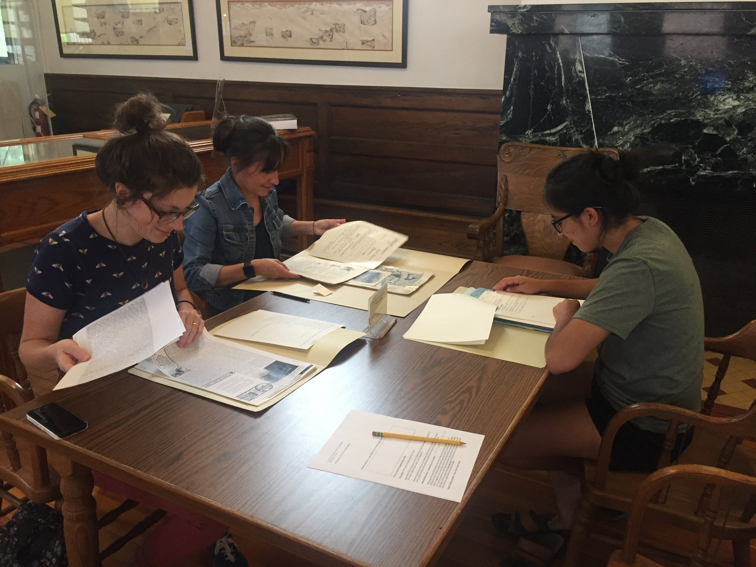 Bridge Program students Allie, Alendra, and Vanessa in the archives at Carnegie Library for Local History in downtown Boulder.