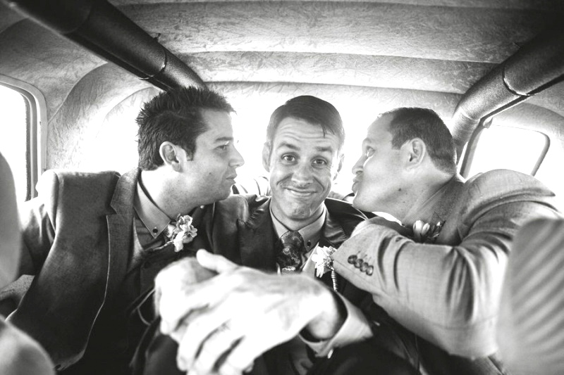Happy gay men in car - relationship expert Terry Klee