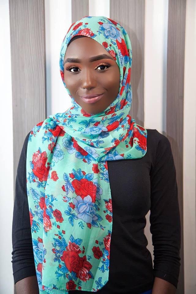 Model Maimuna Bah wearing a floral hijab from the new collection from ANIQ modesty.