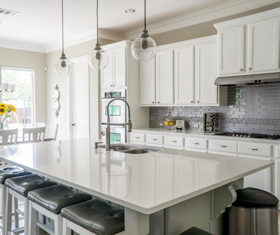 white kitchen gray barstools.png