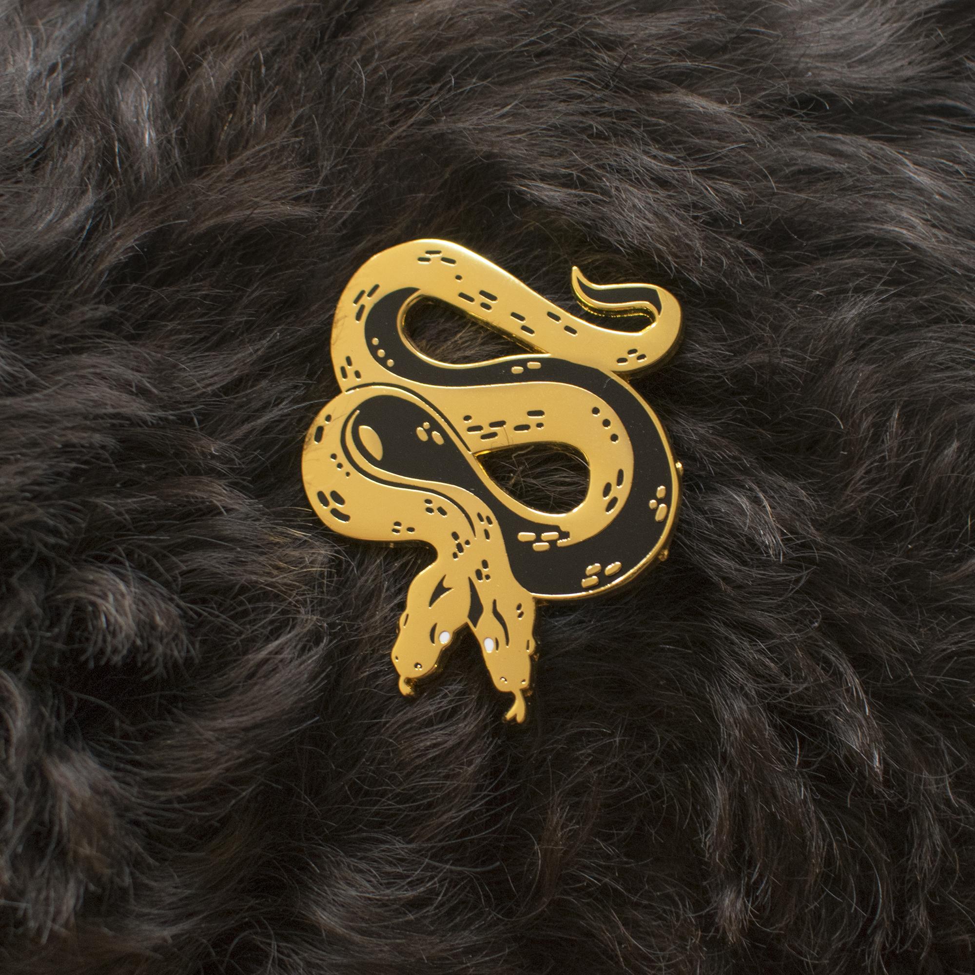 snake logo pin.png