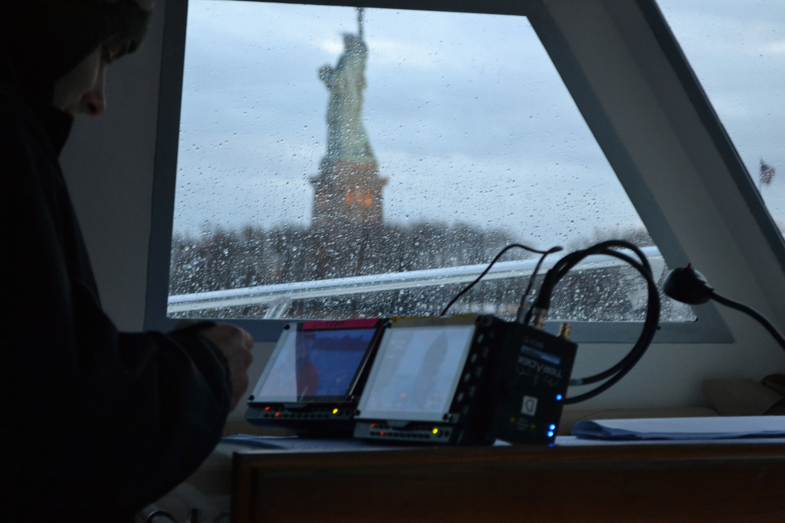 Shooting reality show by Statue of Liberty.