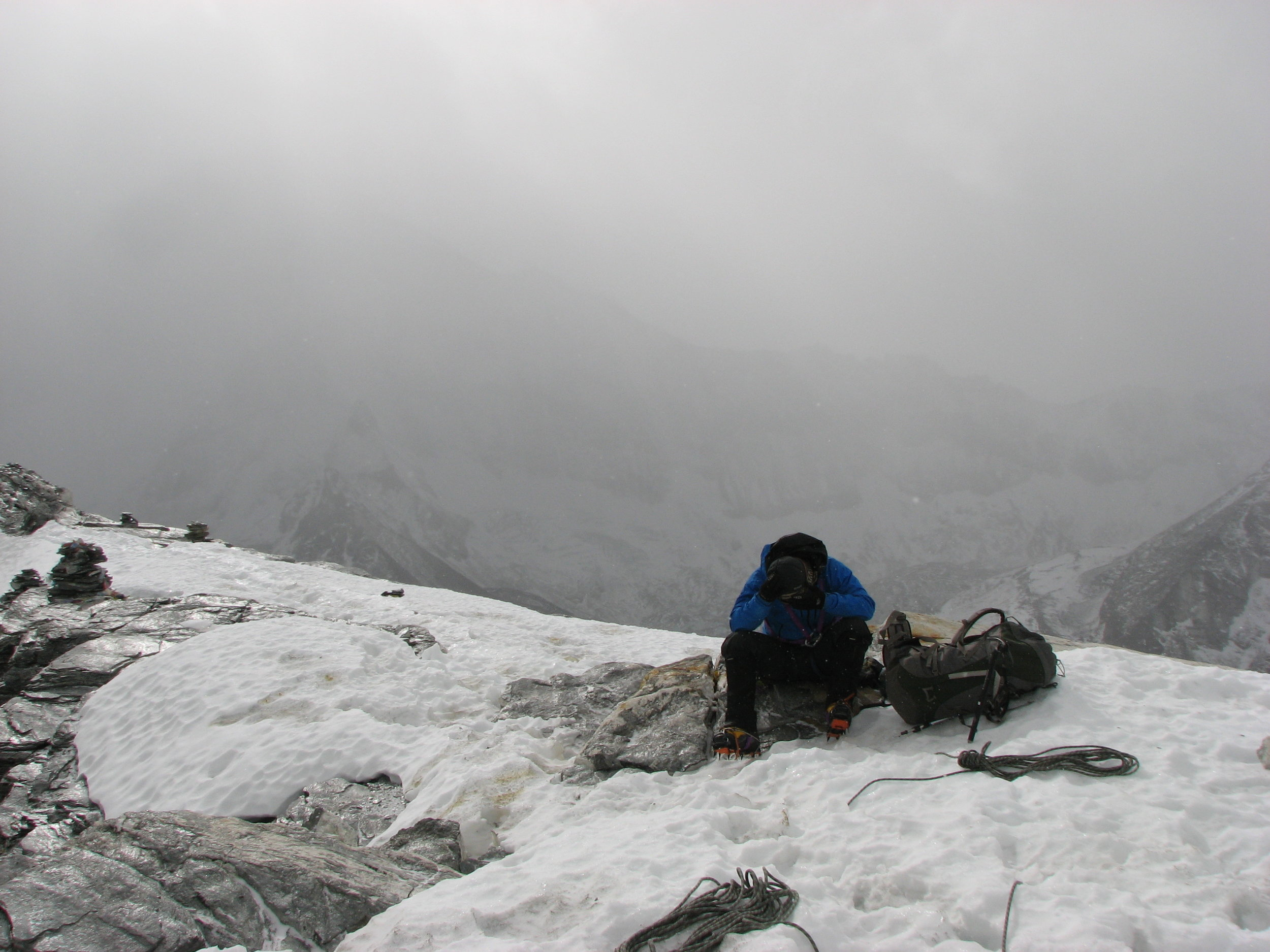 Forrest feeling the altitude and dismay after not summiting while bad weather rolls in from behind.