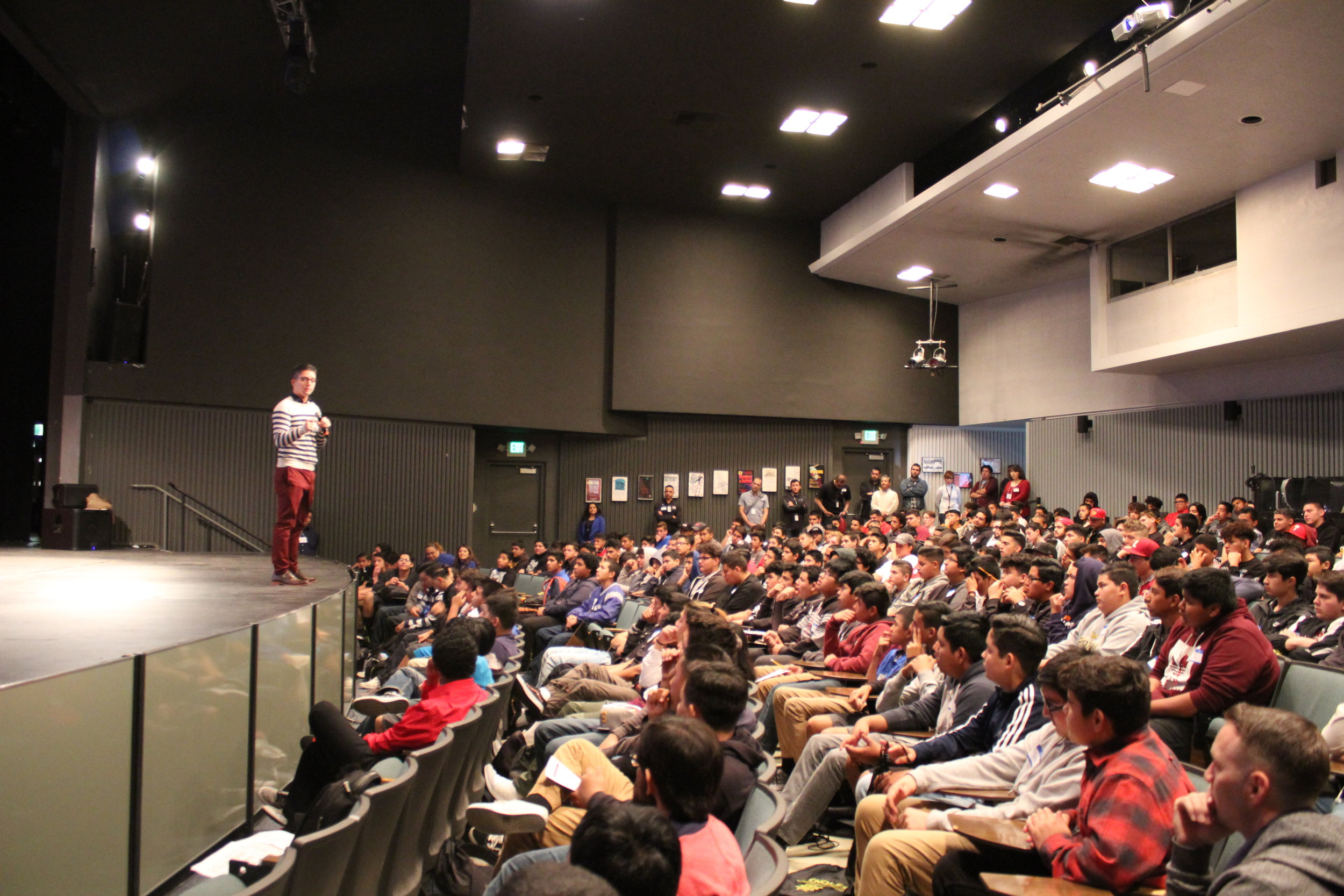 Richard giving a presentation in a packed auditorium