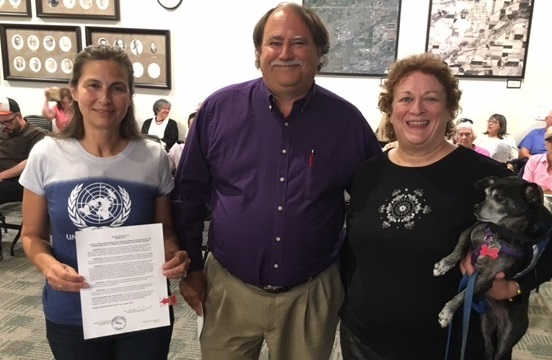 WOCOBOCO members Veronica Hrutkay and Sharon Simmons are joined by Louisville Colorado Mayor Bob Muckle at the city's vote to sign on to  Cities for CEDAW .