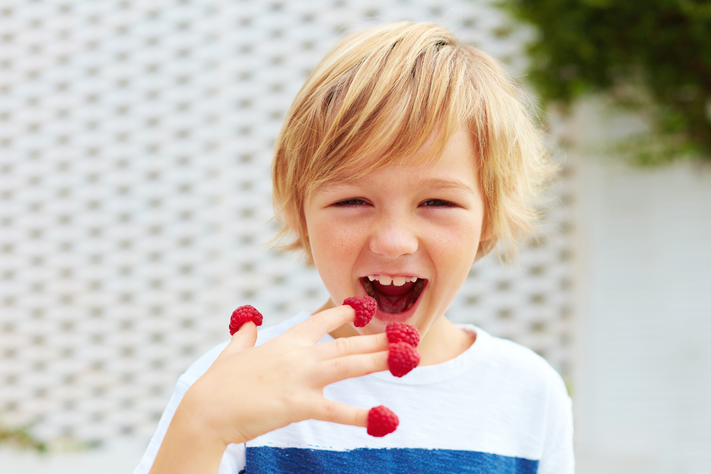 kid with raspberries.jpg