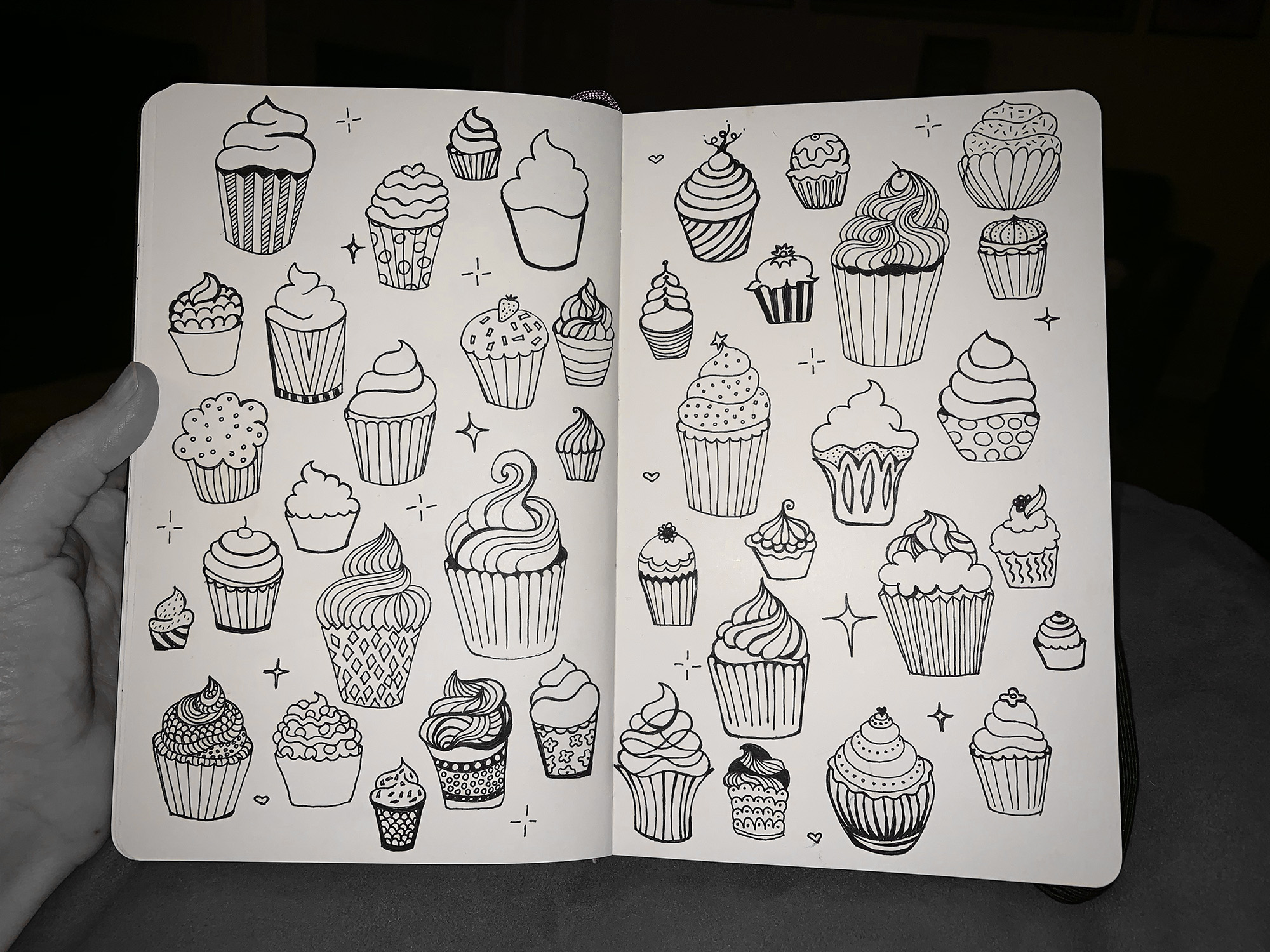 So, first I draw cupcakes in my sketch book. Then…