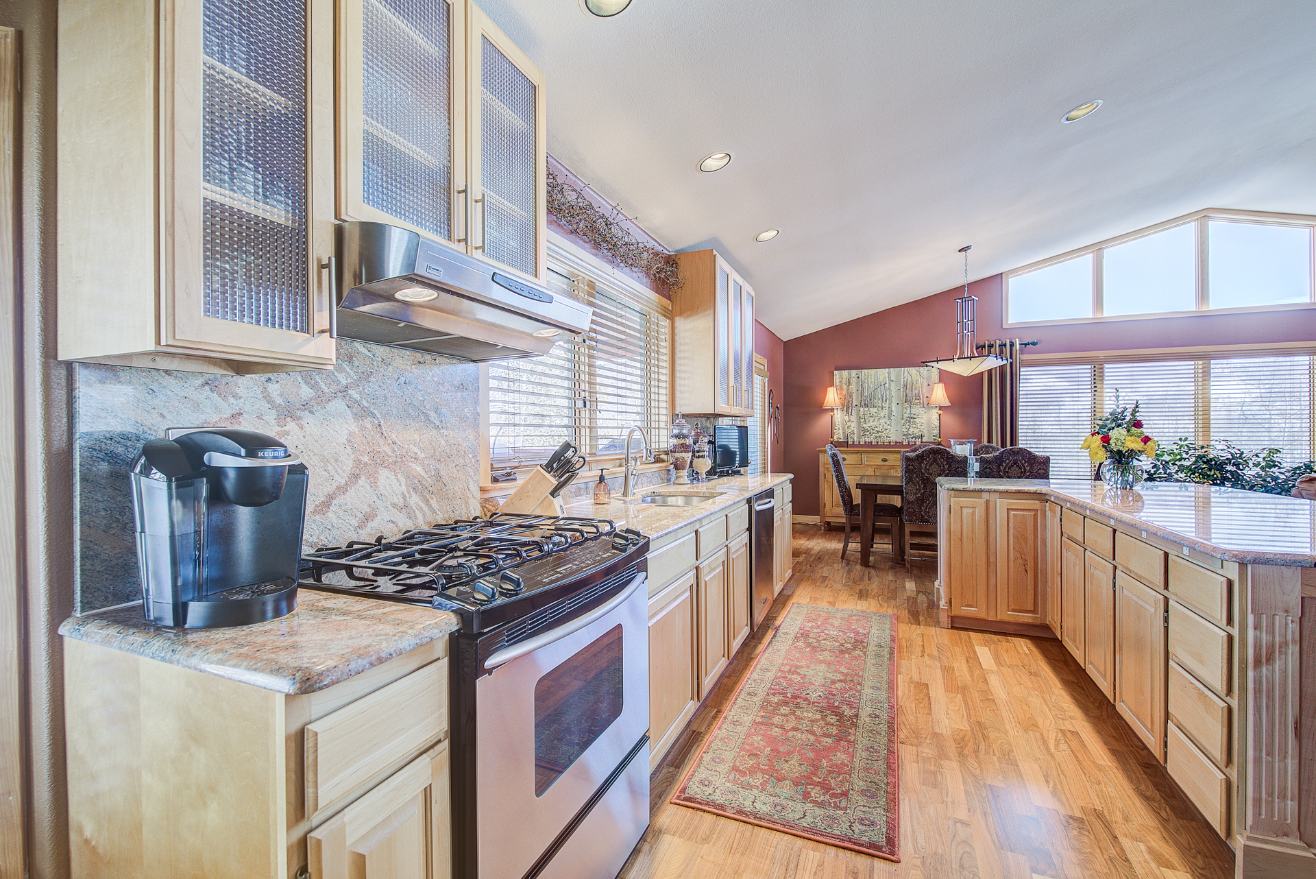 Stainless steel appliances and granite surfaces in the gourmet kitchen