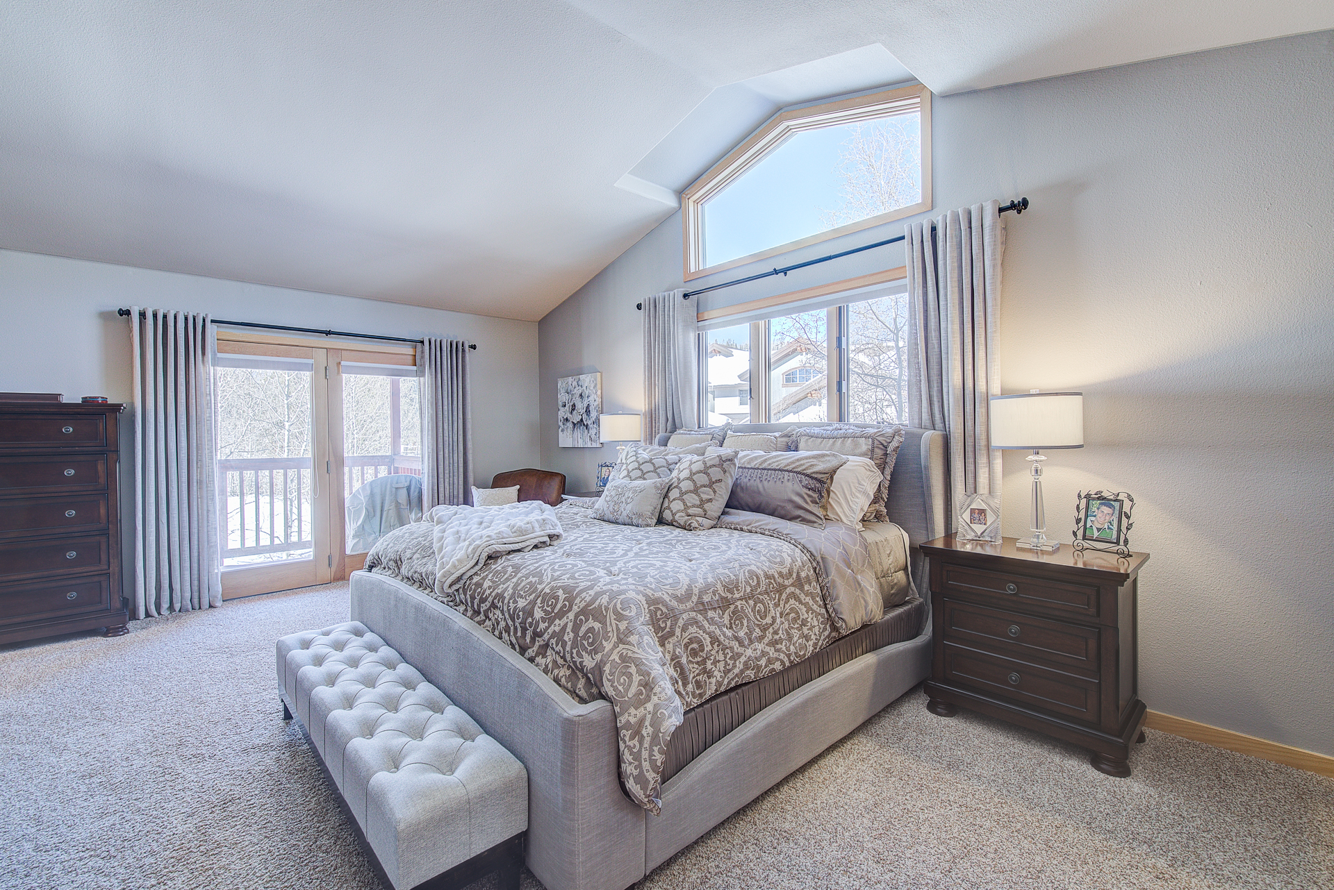 Large master suite with jetted tub, walk-in closet, and mountain views