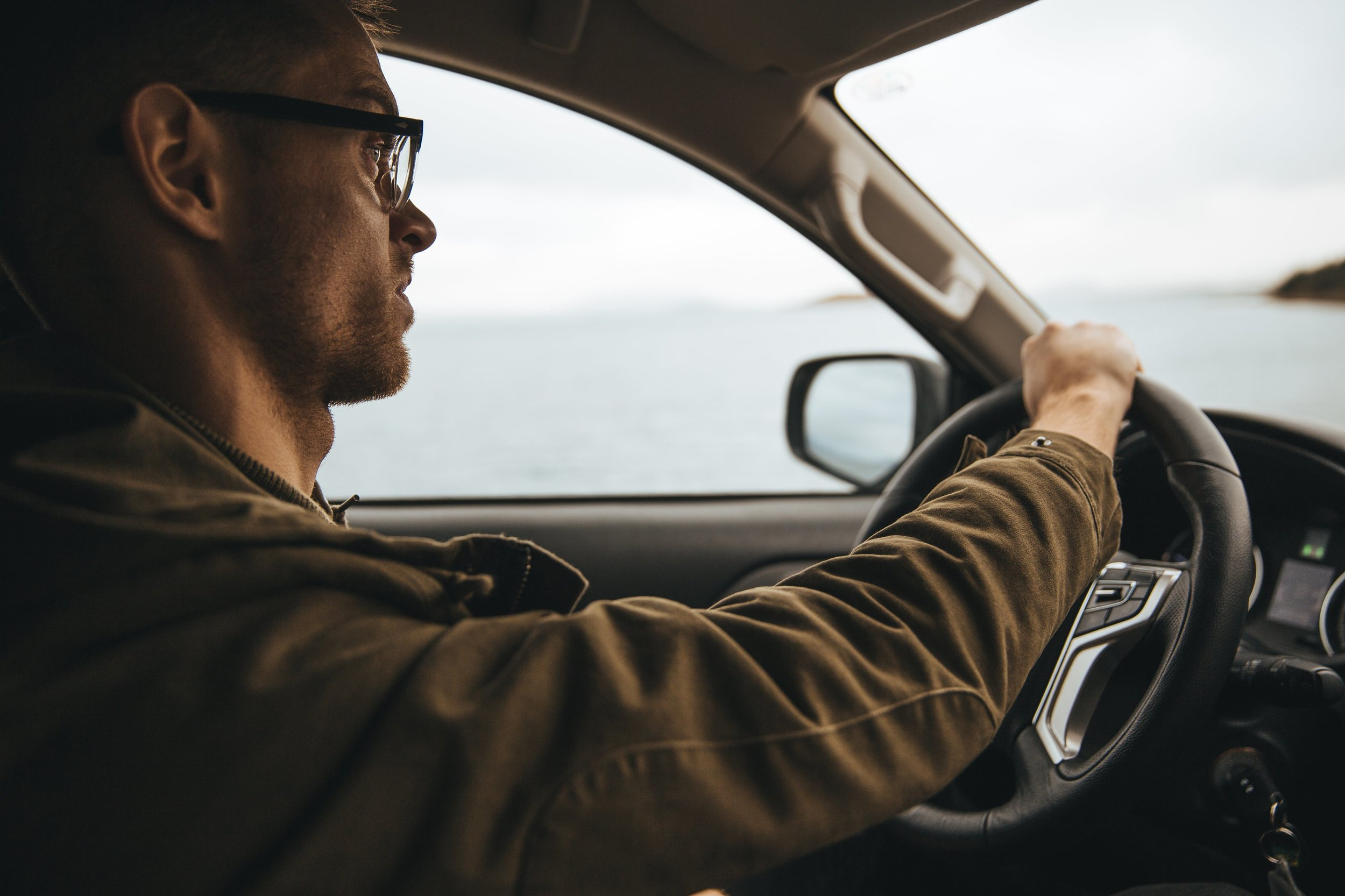 man-with-glasses-driving_4460x4460.jpg