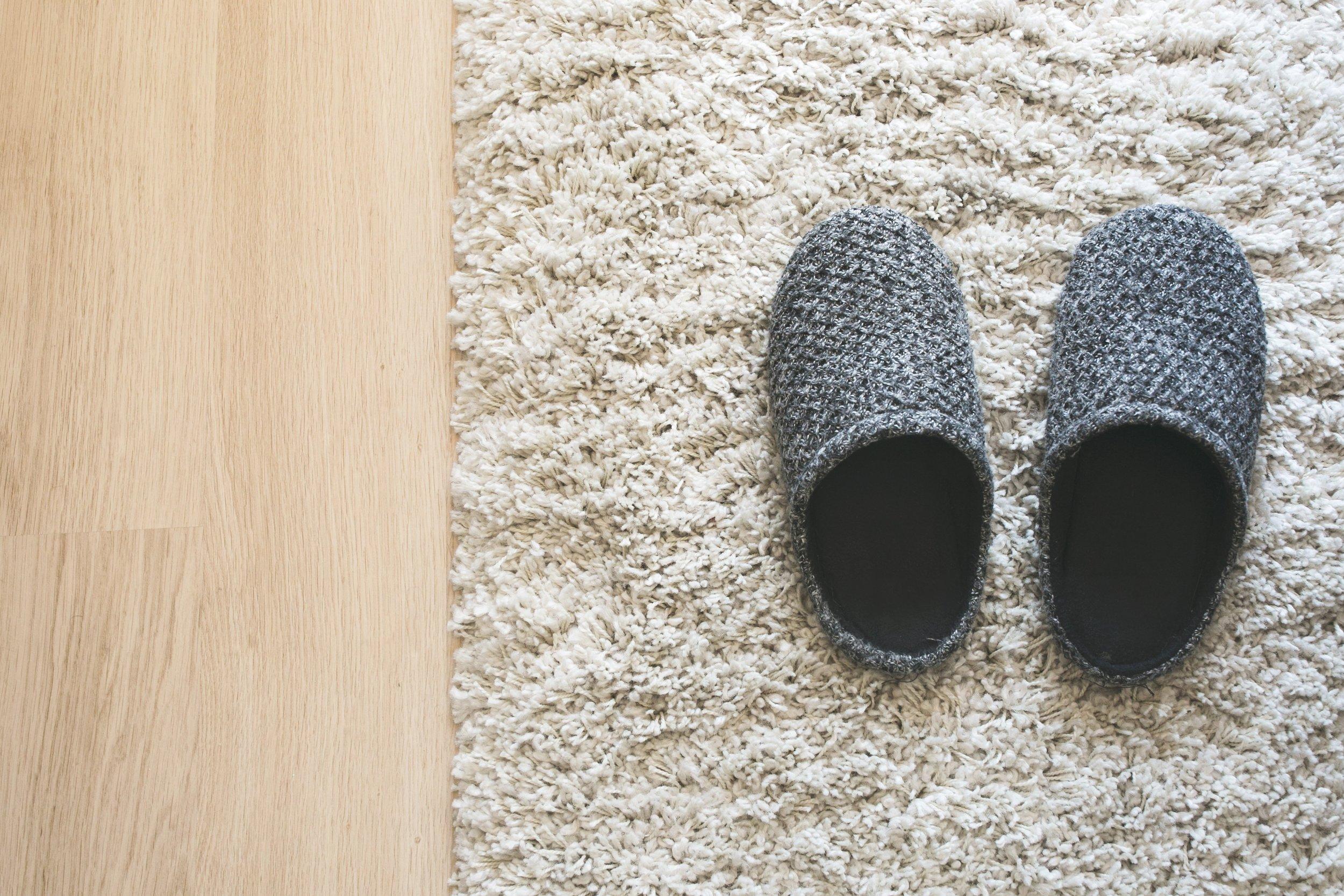 grey-slippers-on-carpet_4460x4460.jpg