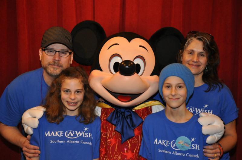 family_photo_with_mickey.jpg