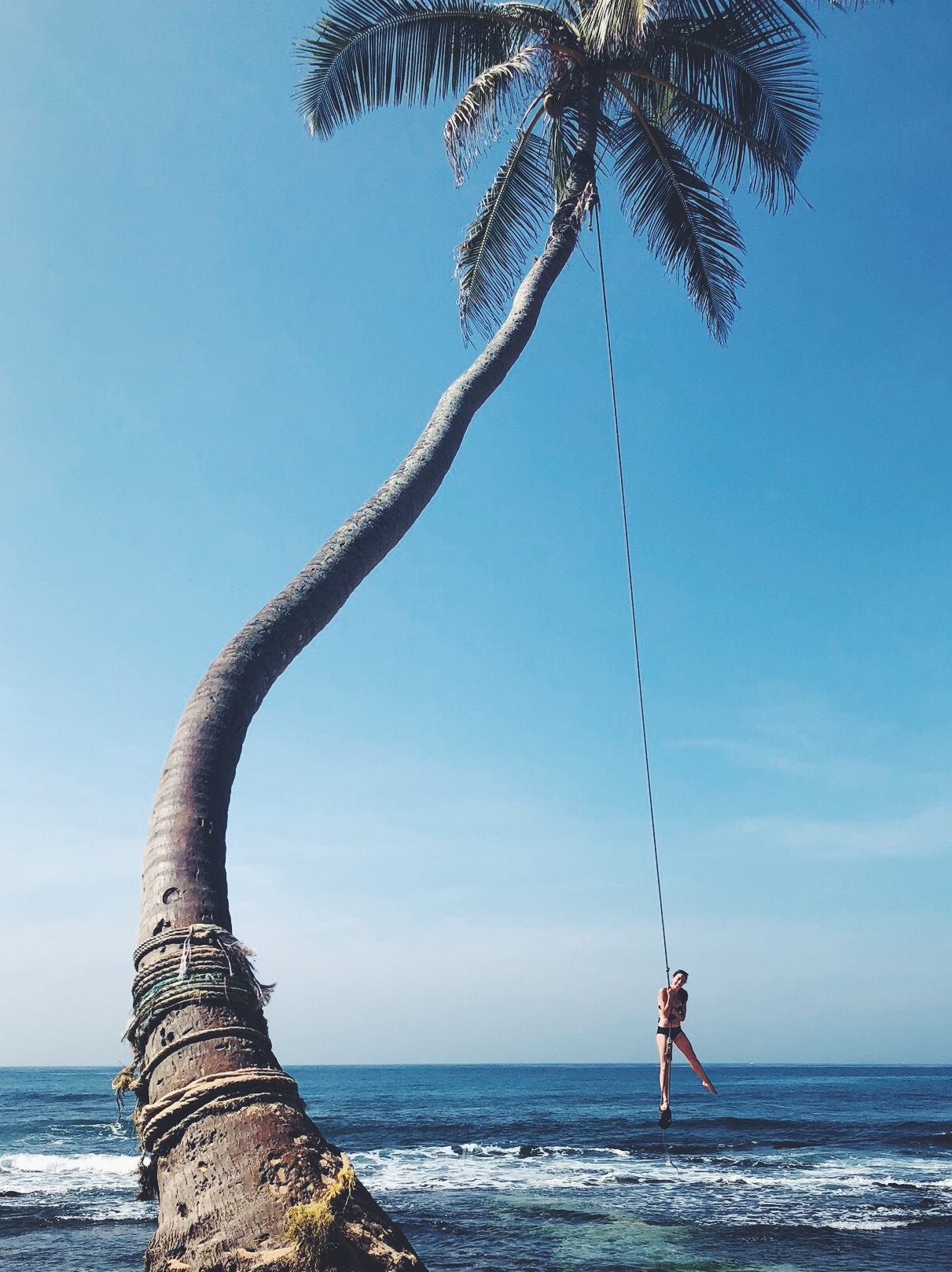 Dalawella Beach - Dalawella beach is just a small town, but this palm tree rope swing makes it worth the extra stop. Head over to Dalawella guest house for a smoothie and spend $3 to hop on the rope swing and swing until you can't swing anymore.