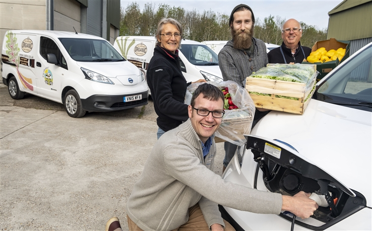 Duncan Catchpole from Cambridge Organic Food Company with, from left, Carole Brook, Jack Arnold and Mike Smart - and the firm's branded electric van range. Picture: Keith Heppell, Cambridge Independent.