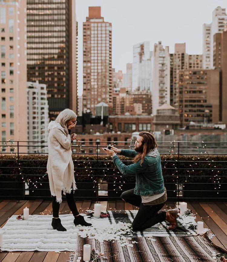 """Source: Wild Heart Visuals  Make your love blossom with a magical yet, traditional route. Including a rooftop, candlelight, flowers and the view of the city. Hearing them say """"Yes"""" would be so easy."""