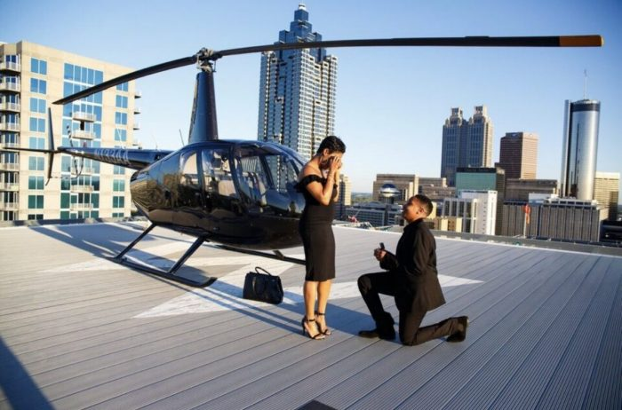 Source:  Nina Parker   Helicopter rides were always a nice treat to show your love for one another. Bringing a bottle of bubbly to honour your new beginning together will truly make it special.
