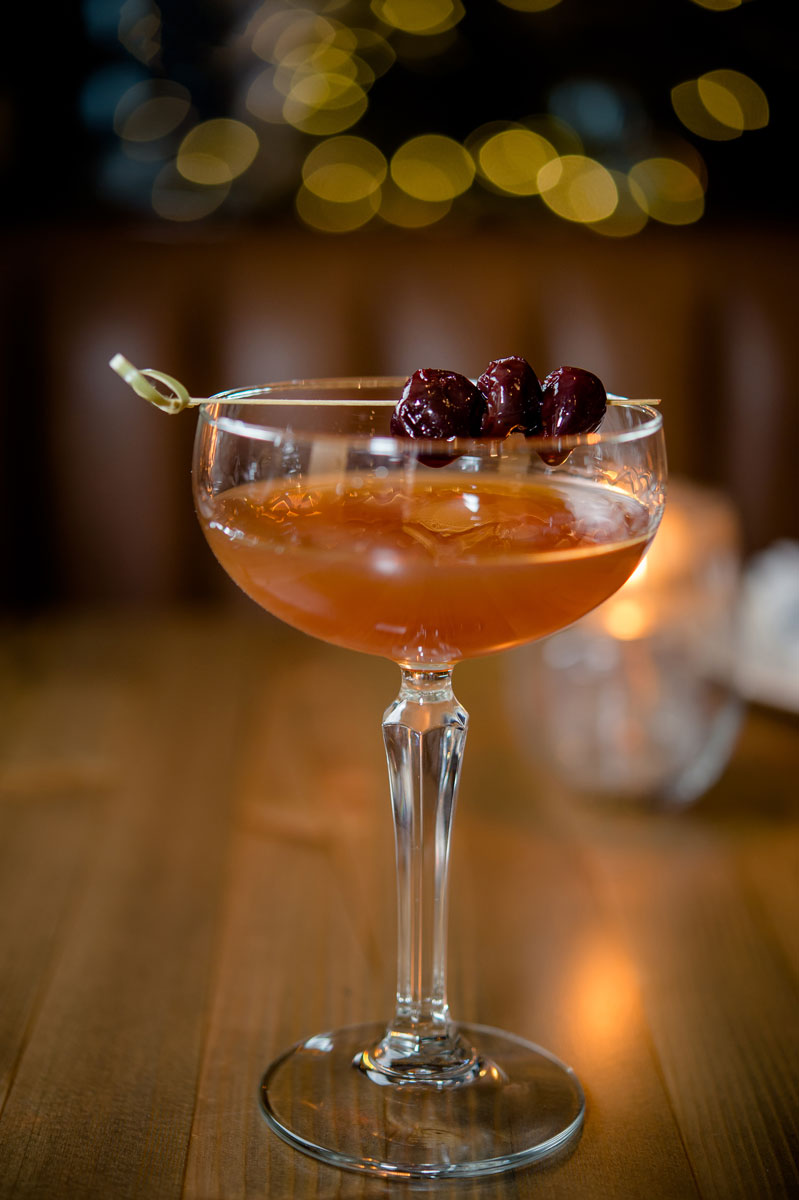 cocktail with cranberry garnish