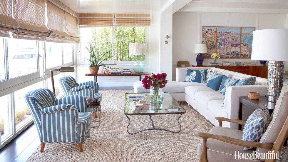 Living Room   The living room mix: Dunham's contemporary sofa accented with pillows in vintage indigo Japanese textile; a wrought-iron coffee table by Parisian designer Jean Royère; and 1940s Swedish chairs covered in  Clarence House 's Rigato.