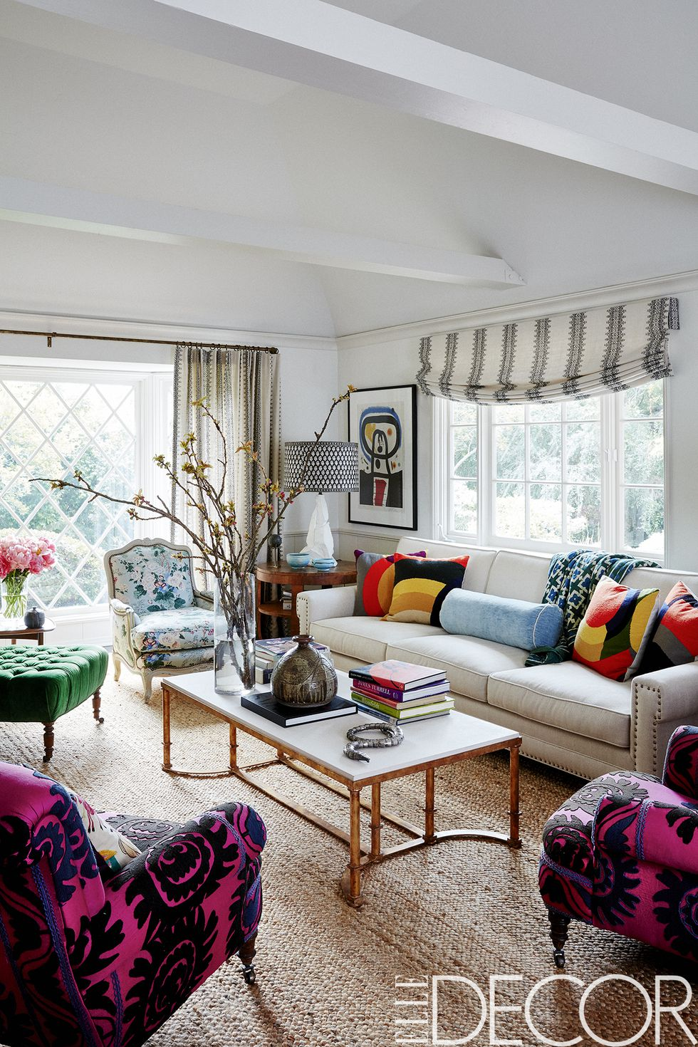 The living room sofa is covered in a    Schumacher fabric   , the cocktail table, the 1940s Italian walnut side table, the lamp and the jute rug are all from    Hollywood at Home   . The '50s French bergère is covered in a    Lee Jofa floral    and vintage French armchairs are upholstered in a 1960s suzani.