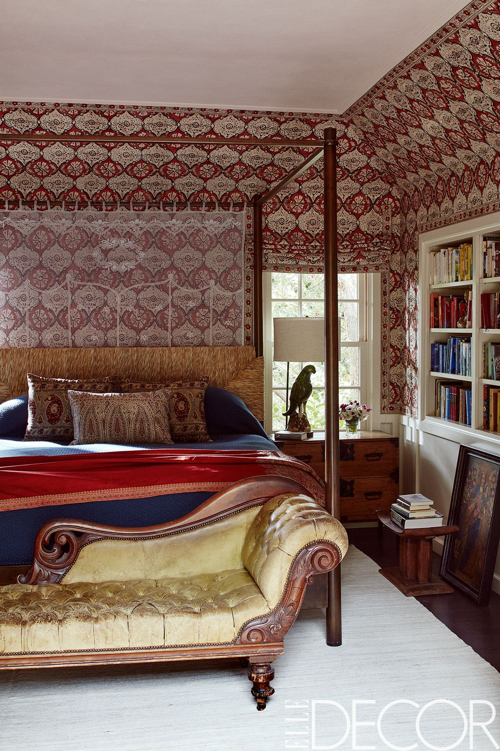 In the master bedroom, the bed by    Hollywood at Home    is dressed in    Deborah Sharpe Linens   , the antique George IV settee retains its original leather and the wall covering and shade are of    Minnie Maharani    by    Peter Dunham Textiles   .