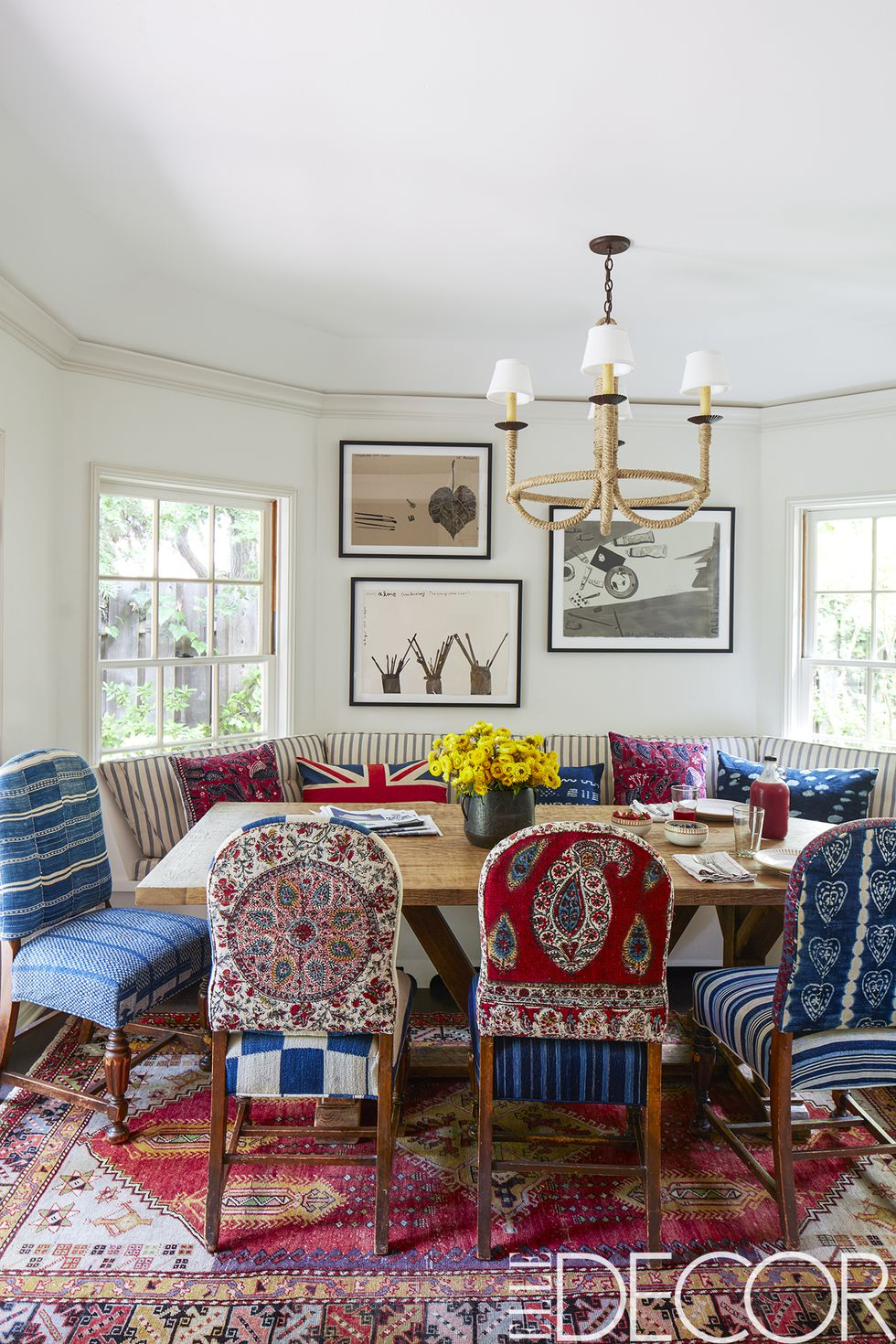 The chairs in the dining area came from Driver's former house and were re-covered in vintage Islamic and African textiles, the banquette is covered in a Pindler stripe, the chandelier is by    Hollywood at Home   , the vintage rug is from    Jamal's Rug Collection    and the watercolors are by   Konstantin Kakanias  .