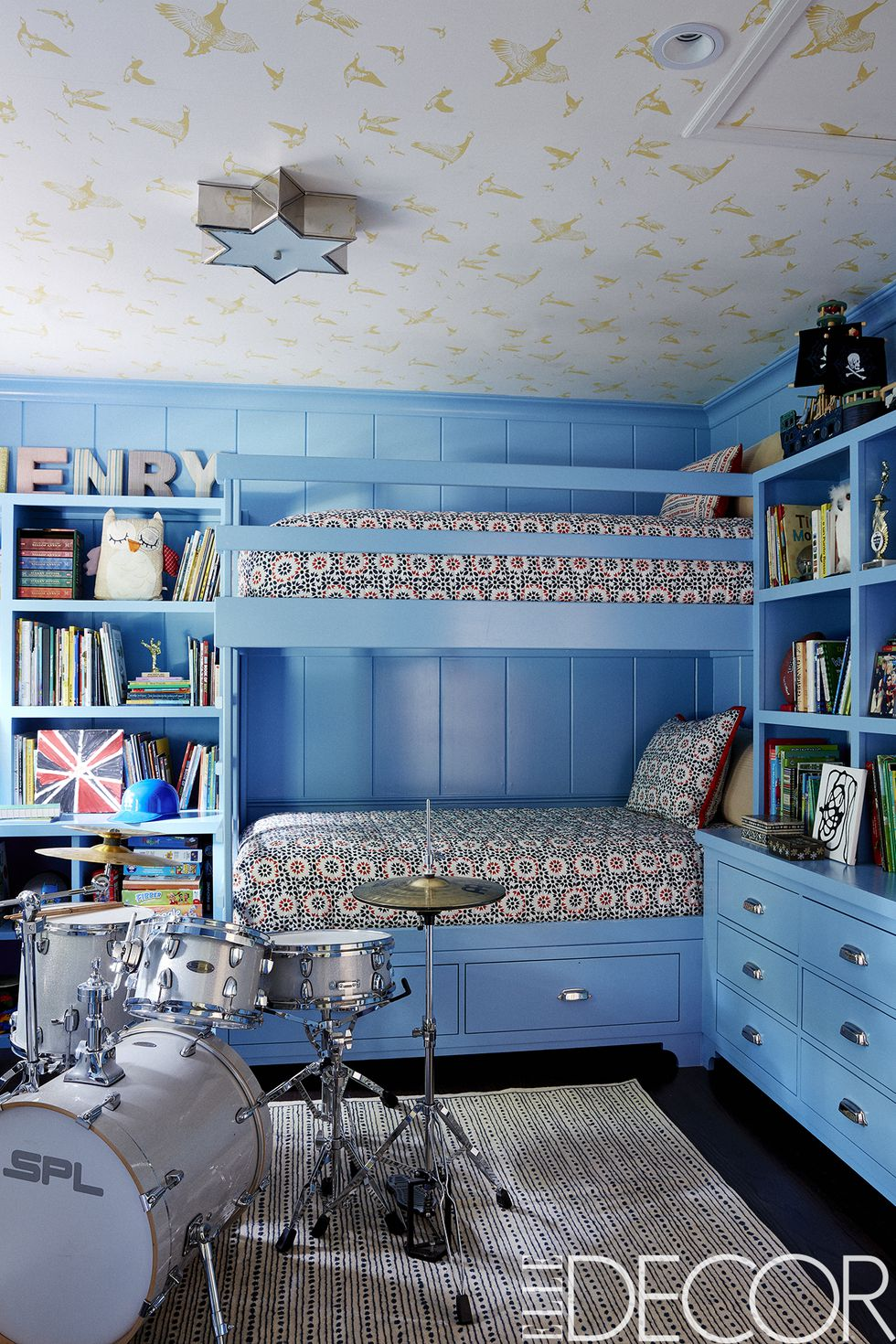 In Driver's son's bedroom, the bunk beds and cabinetry are painted in    Benjamin Moore's Poolside    and the bedding is from    Driver's home collection for HSN   .