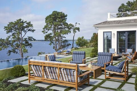 """It's so rare to have trees between the house and the view; these big pines make it feel like the South of France to me,"" says designer Peter Dunham of this Hamptons, New York, home.  Furniture:  Peter Dunham Home."