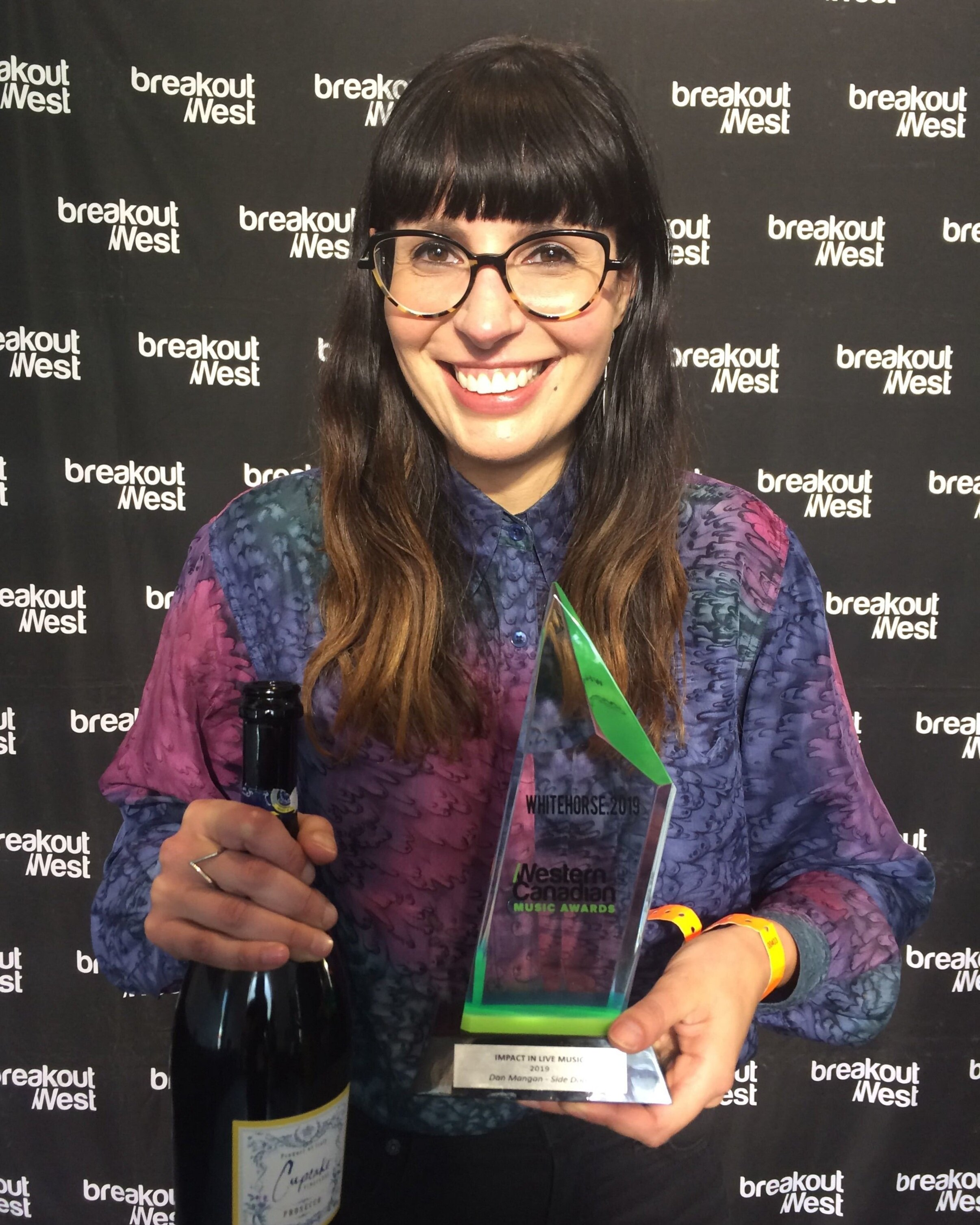 Gianna accepting our award for Impact in Live Music from BreakOut West