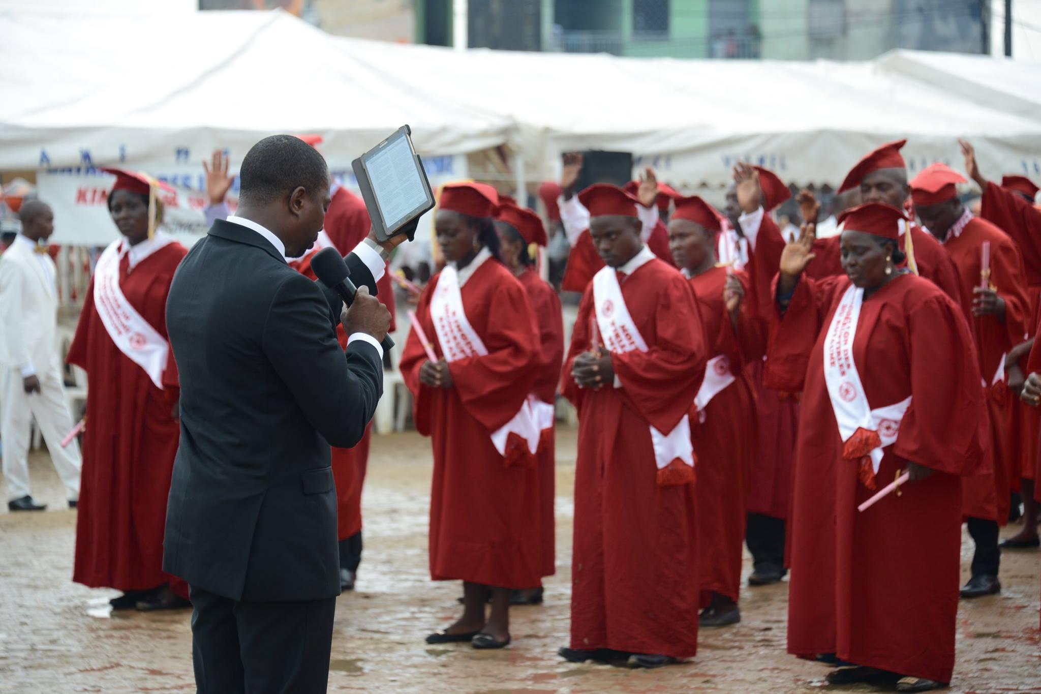 Charles praying for graduates
