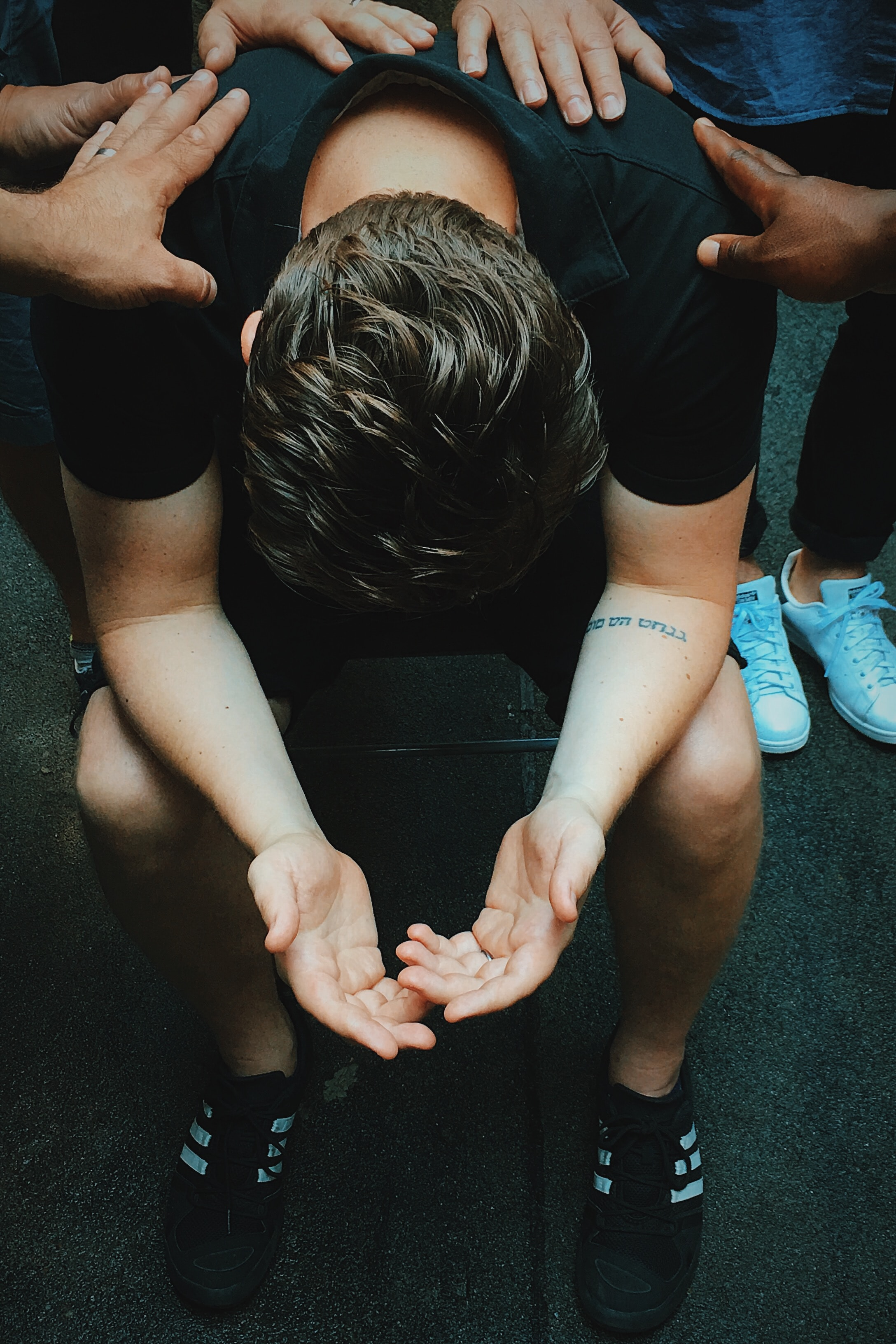 Man being prayed over.jpg
