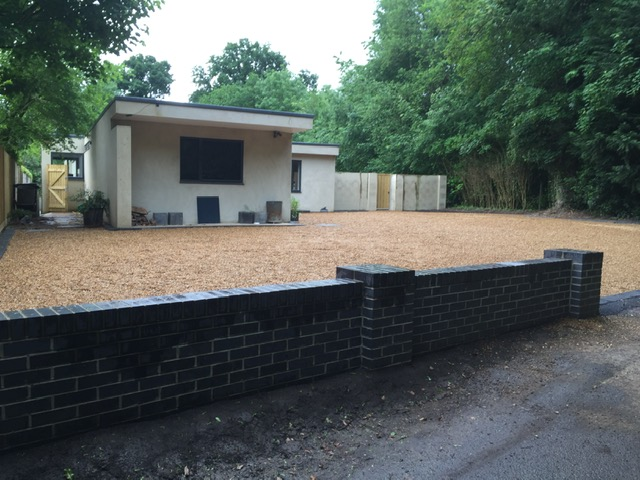Gravel with additional brick walls