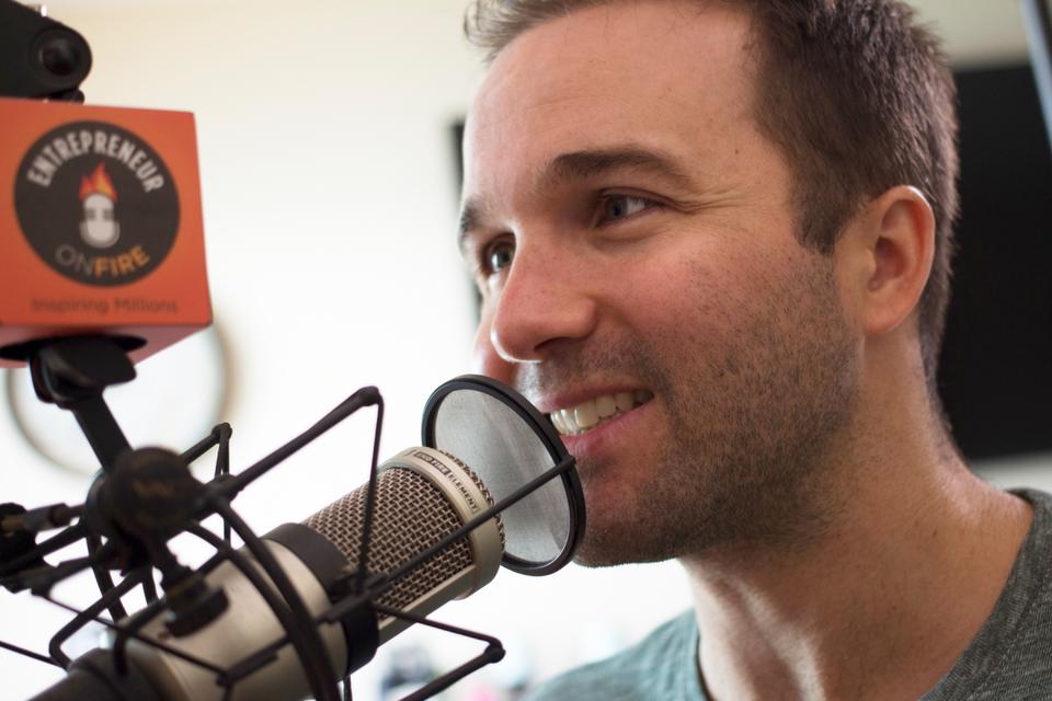 John Lee Dumas hosting Entrepreneurs on Fire, an award-winning podcast. PHOTO CREDIT: MATT BOUVET