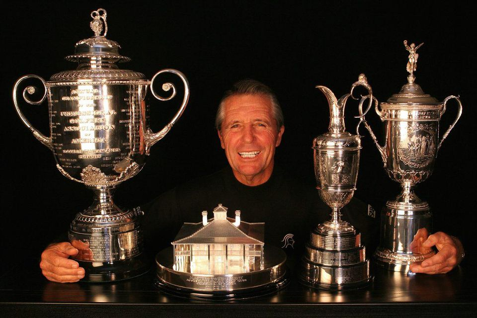 Gary Player pictured with all four of golf's Major Championship trophies.  IMAGE COURTESY OF BLACK KNIGHT ARCHIVES