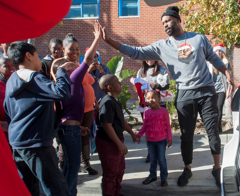 Davis hanging out with kids from his neighborhood. PHOTO CREDIT: BARON DAVIS ENTERPRISES