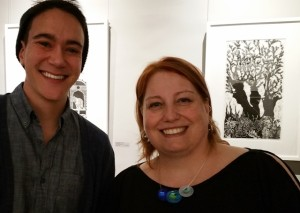 Kris (right) is joined by a young art fan at the opening reception.