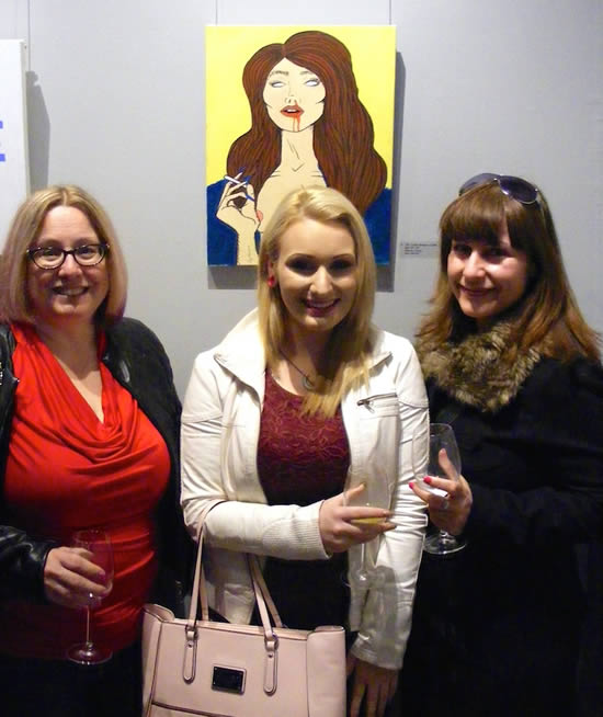 Rhiannon deWit and fans with her painting TROUBLE