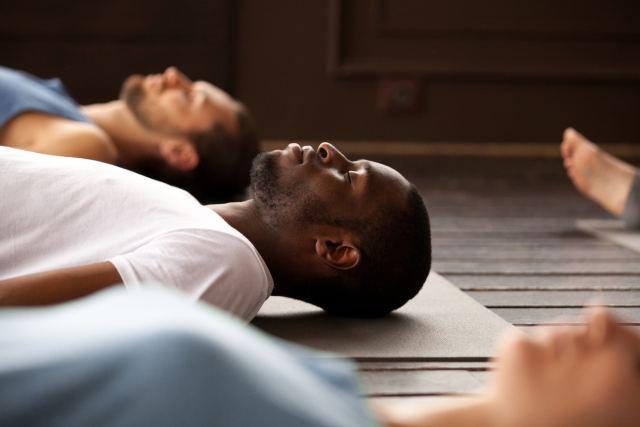 yoga-class-man-shavasana.jpg