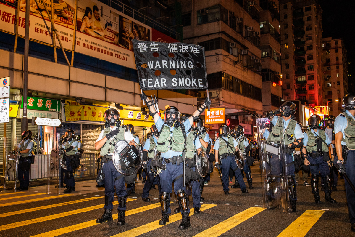 When riot police do this they always remind of ring girls at a boxing match.