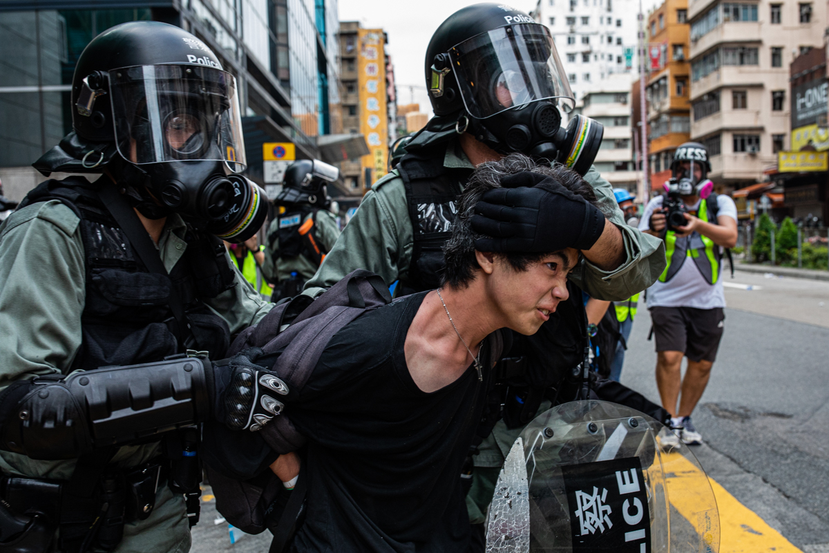 Protestor being arrested after the clearance.