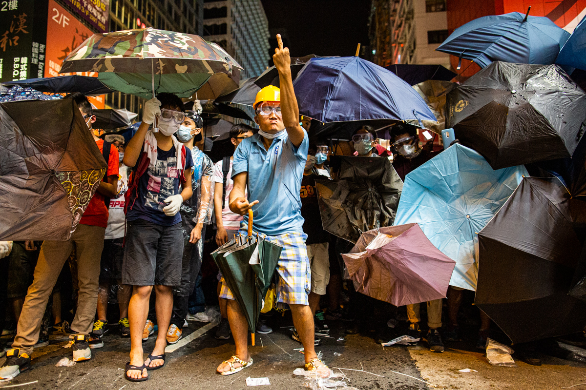 14.10.17 - Hong Kong: Protestors face off with police in Mong Kok. Eric the artist was a well-known protestor.