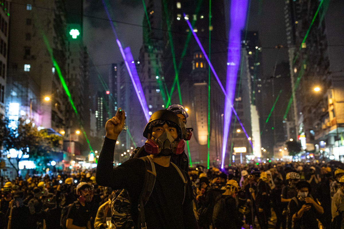 Laser show in Wan Chai as police advance.