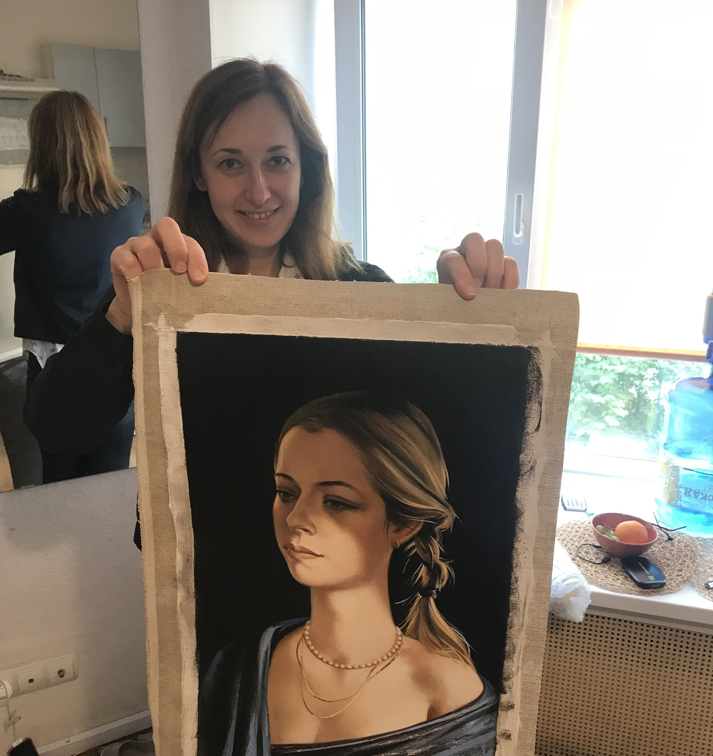 Anastasia Bazanova with the painting of Lucy's daughter Libby painted by her dad Alexey Bazanov