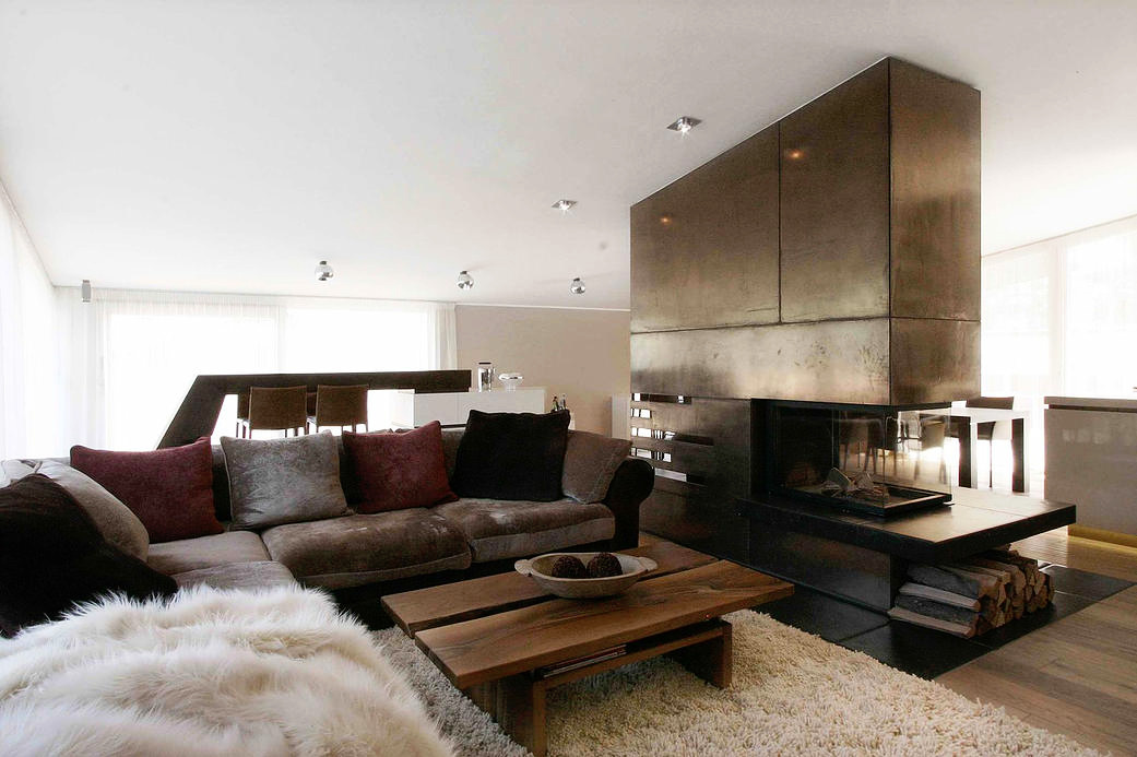 contemporary fireplace with bronze panels