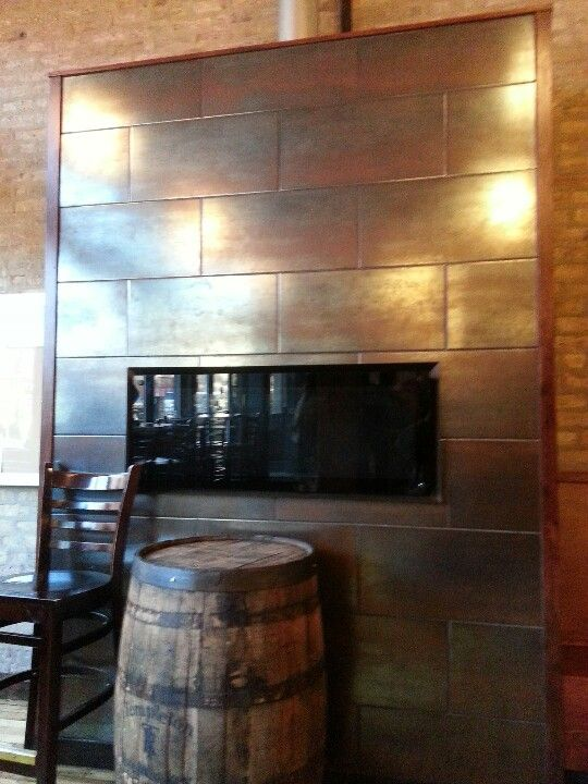 copper aged panels on fireplace