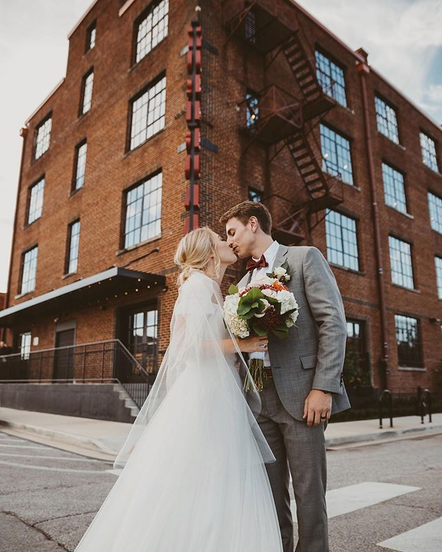 One of our favorite sidewalk shots ft. our marquee from Ellie & Mark's sweet wedding day! 📷: @nataliecahophoto . . . . .  #chattanooga #tennessee #wedding #celebrate #gather #industrial #venue #eventplanner #event #party