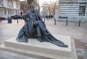 Charles Dickens , 2014, bronze h.1.5m. , Portland stone base h. 20cm., Guildhall Square, Portsmouth, photo: courtesy of Martin Jennings
