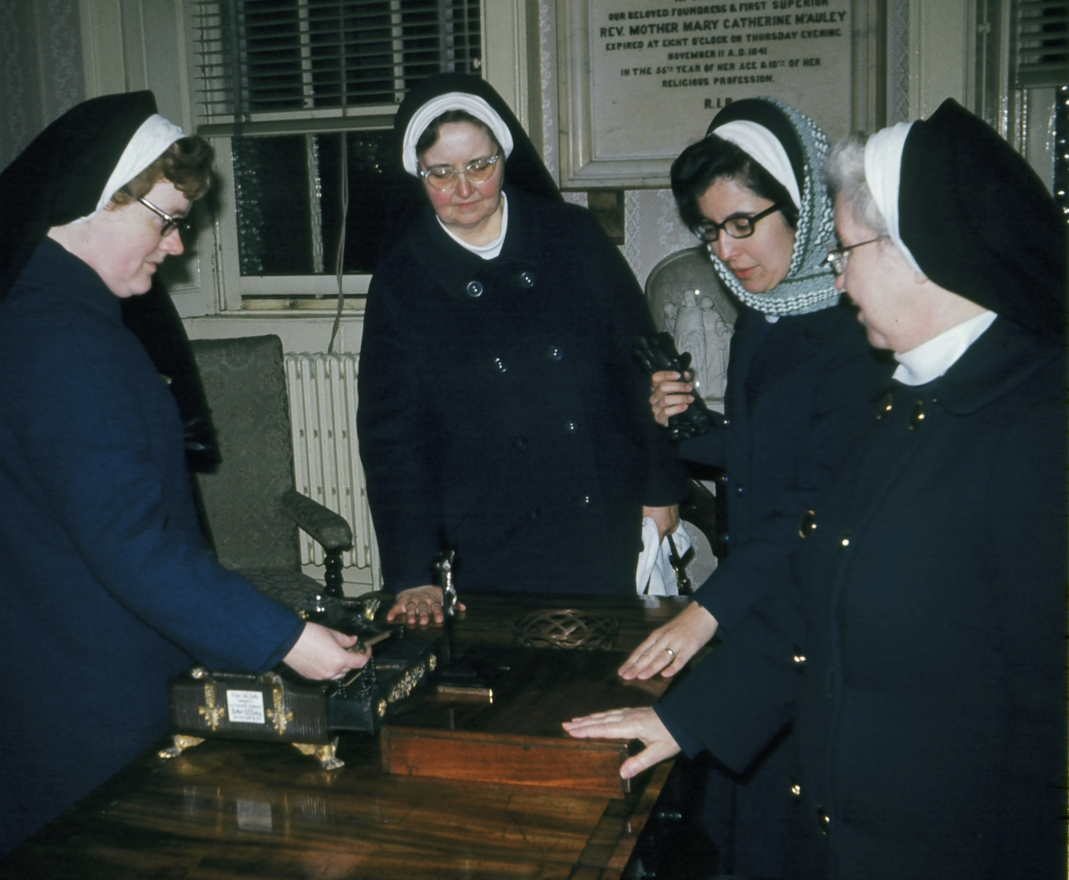 In the midst of the refoundation, the Founding Mothers of the Religious Sisters of Mercy of Alma, Michigan visited Baggot Street in Dublin, Ireland (Mother Catherine's first foundation for the Sisters of Mercy). Here, four of them are at Mother Catherine McAuley's writing desk, as she left it, in her room (the writing desk is also pictured above in the large image).