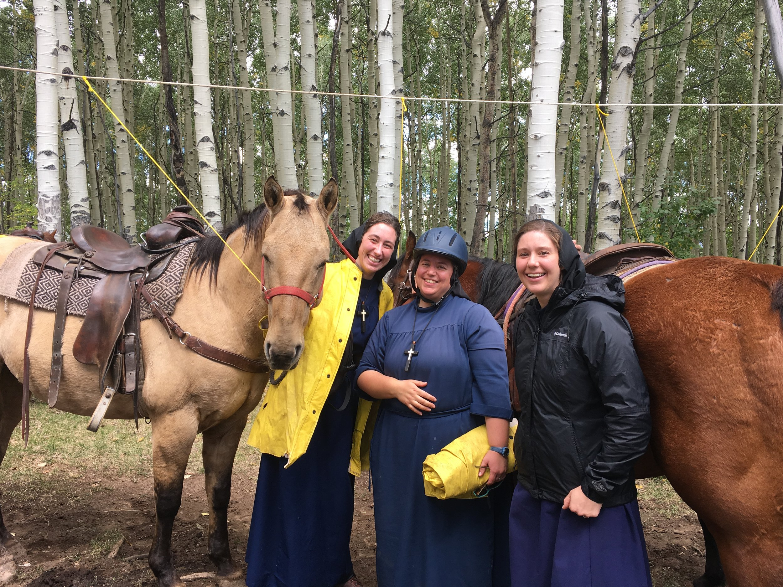 sisters with horses.JPG