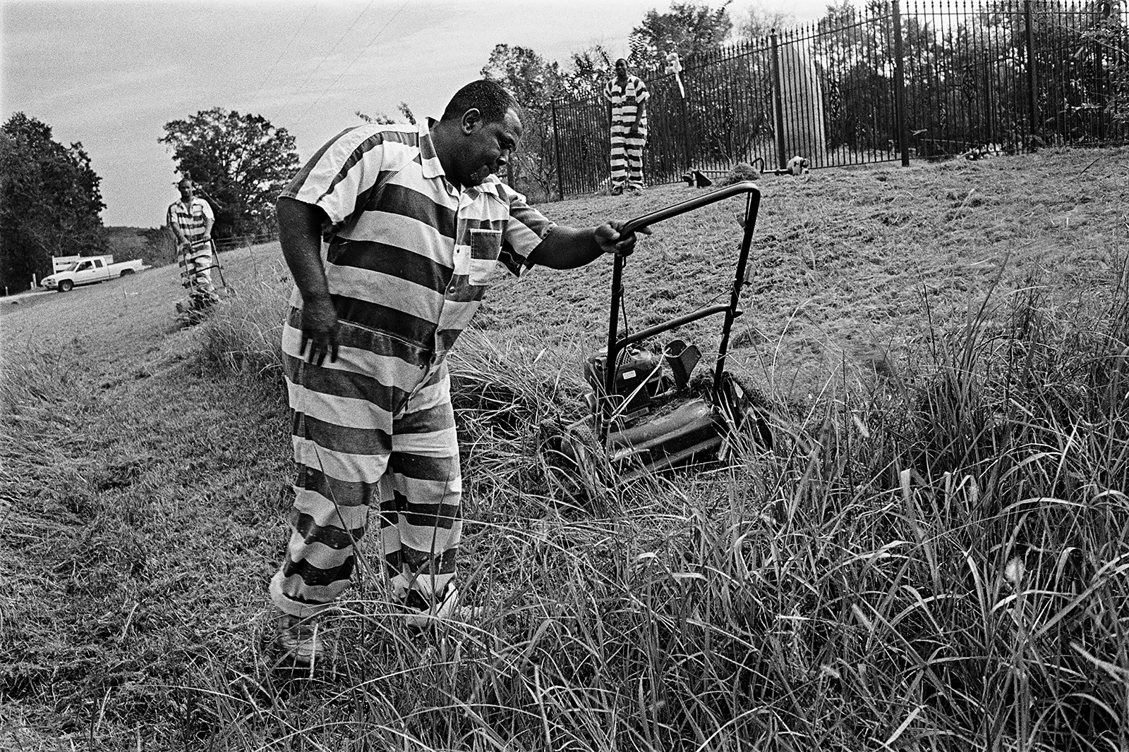Convicts Mowing around the Viola Liuzzo Memorial Marker, between Selma and Montgomery, Alabama, 2009